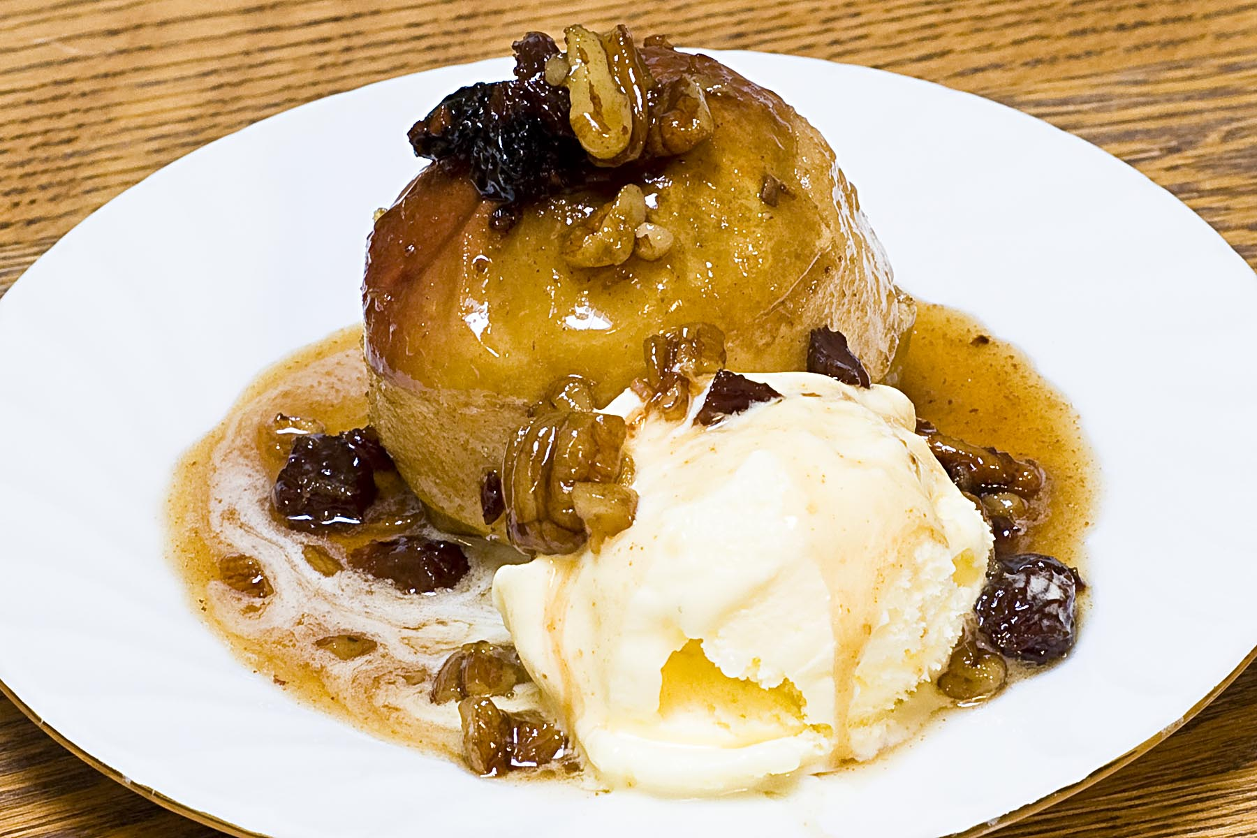 Serve the warm baked apples with vanilla ice-cream and a spoonful of ...